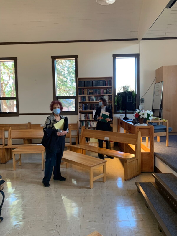 A photo of Senator Jaffer and her assistant Madison standing inside the chapel at William Head Institution near Victoria, British Columbia